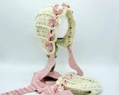 Heirloom 'Ohana Bonnet in 'Ivory' with crinkle cut pink satin ribbon.