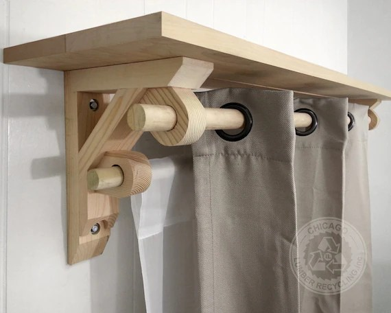 double rod wooden braces for supports up to 12 shelf and a standard 1 25 rods curtain and drapery brackets lc200x2 pair