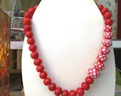 Red polka dot pearls neck...