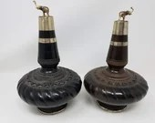 Pair of Carved Pottery Wine Bottles with Silver Elephant Stoppers