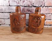 Pair of Leather Wrapped Whiskey Flasks or Bottles with Lids
