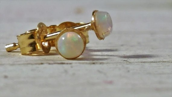 Handmade elegant 9carat gold stud earrings with a natural pearlescent Opal