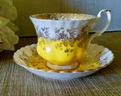 Royal Albert ''Regal Series'', England / Yellow And Gold Tea Cup with Saucer