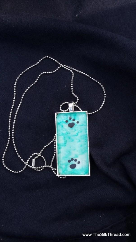 "Paw prints Necklace, silk jewelry, Hand painted silk pendant, 1"" x 2"", Handmade silk art by artist, blue green background organza gift bag,"