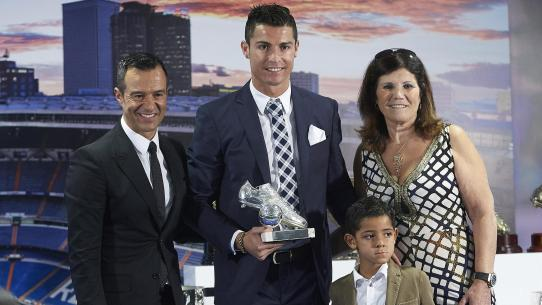 Cristiano Ronaldo with his agent, mother and son.