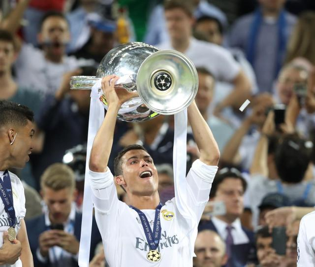 Real Madrids Cristiano Ronaldo Celebrates With The Trophy After Winning The Uefa Champions League