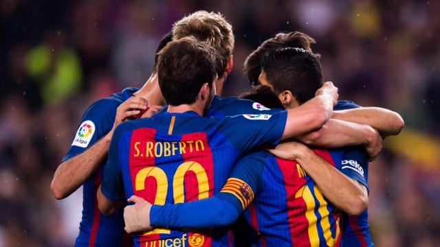 Players of FC Barcelona celebrate after their teammate Lionel Messi scored the opening goal during the La Liga match between FC Barcelona and Real Sociedad