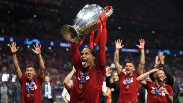 Virgil van Dijk of Liverpool lifts the Champions League Trophy
