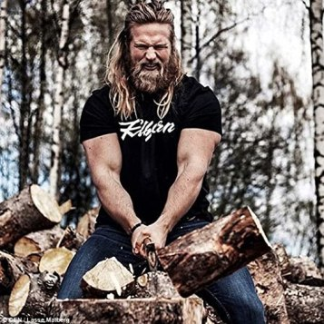 Lasse showed his butch side with a snap of him wood chopping, with the caption: 'Hit the #...: