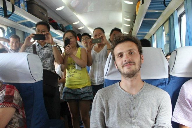The look on your face when a half naked lady approaches you and the whole train is watching. Never a boring day in China.