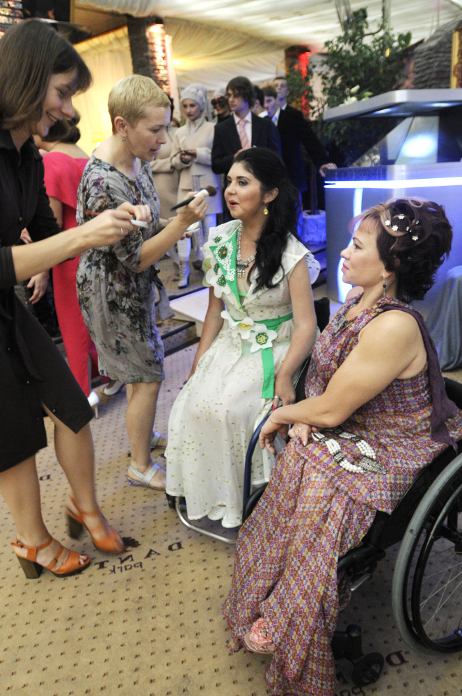 Models in wheelchairs preparing for Fashion Chance