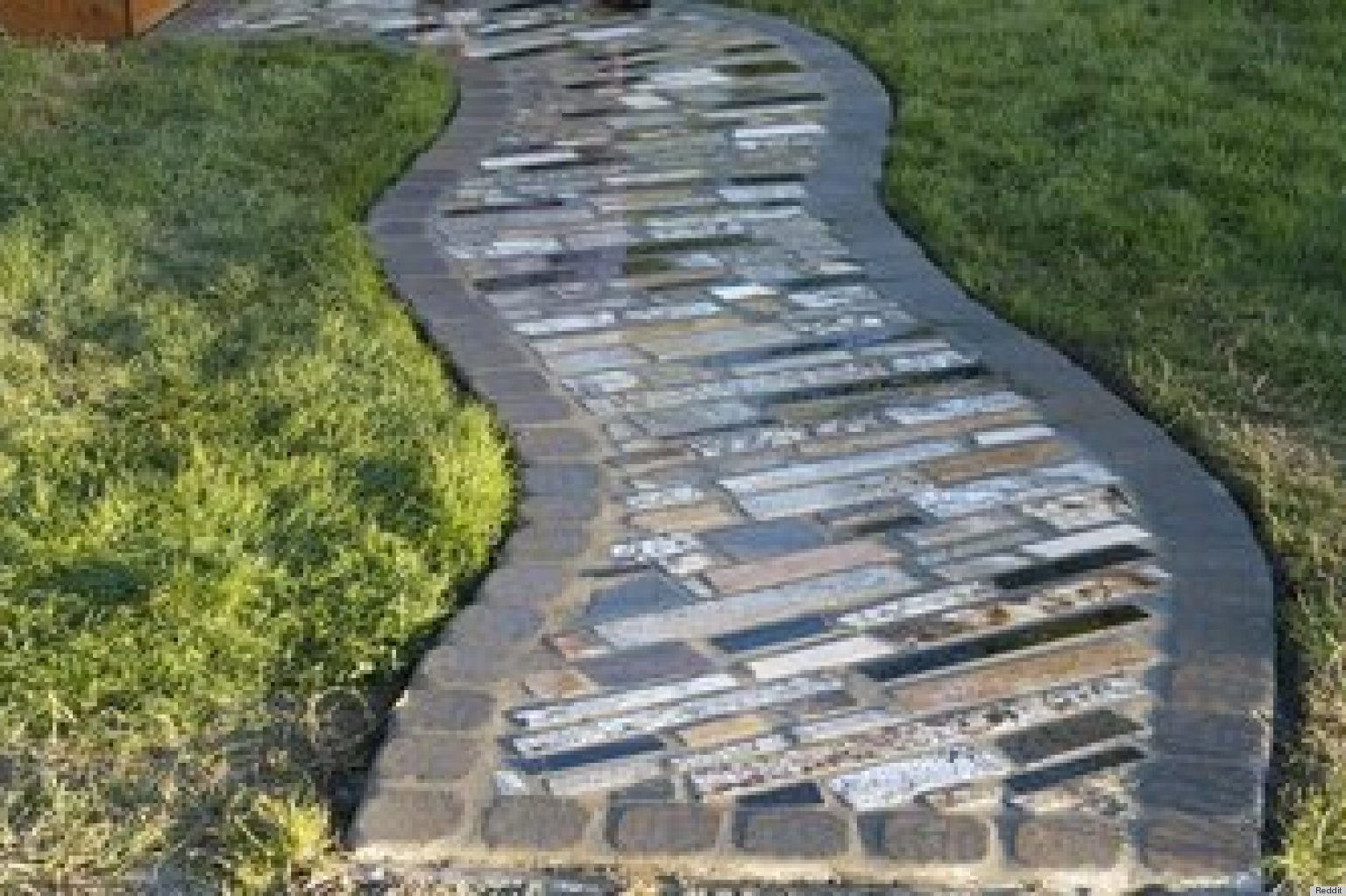 Couple Builds Impressive DIY Walkway Using Free Scraps Of ... on Backyard Walkway Ideas  id=19308