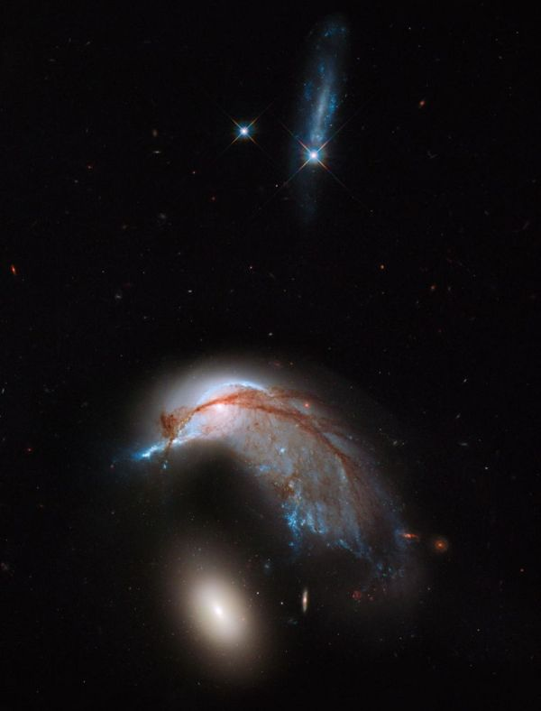 Hubble Telescope Reveals 'Cosmic Penguin' As Two Galaxies ...