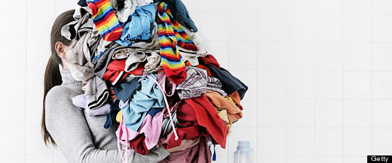 Image result for carrying pile of clothes