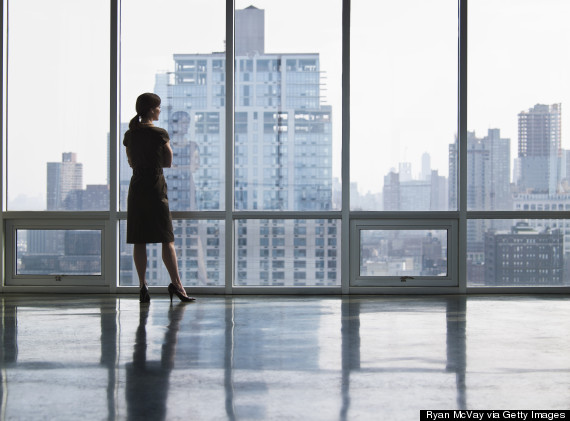 woman office looking out