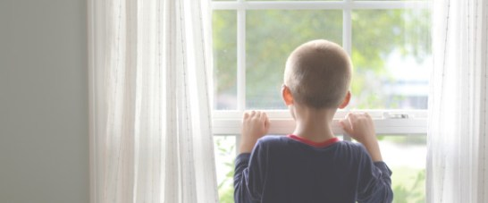 BOYS LOOKING OUT WINDOW