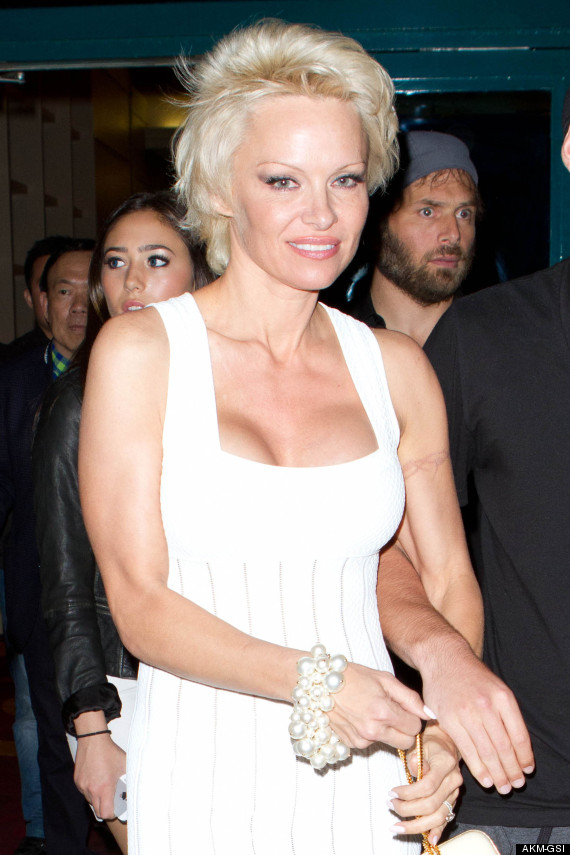 Pamela Anderson Finally Starts To Remove Barbed Wire