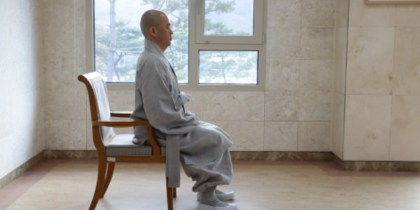 Meditate sitting on a chair