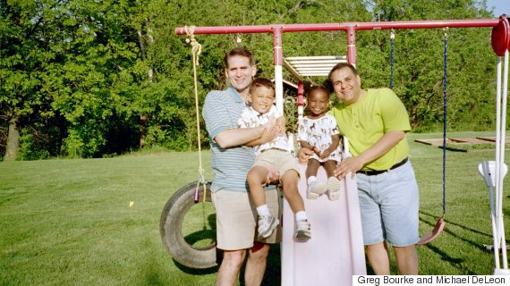 Greg Bourke and Michael DeLeon with their children, Isaiah and Bella, 2003.