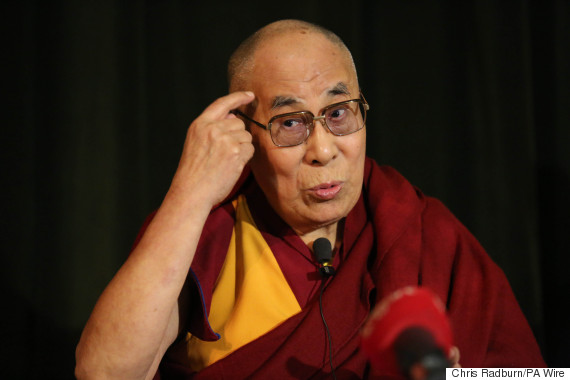 The Dalai Lama speaks during a press conference at Magdalen College ...
