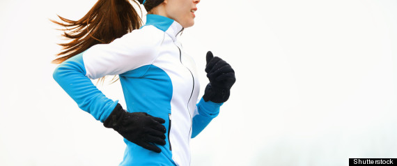 Winter Wardrobe Essentials Woman Running in Winter with Black Gloves and Pants and Blue and White Jacket