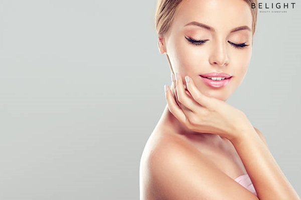 Portrait-of-beautiful-Young-smiling-Woman-with-clean-fresh-skin-touching-own-face-Facial-treatment-C