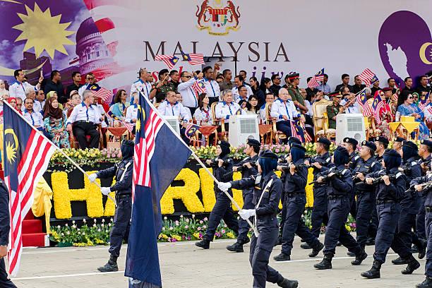 Malaysia-s-Prime-Minister-Najib-Razak-R-and-his-deputy-Ahmad-Zahid-Hamidi-C-wave-national-flags-duri