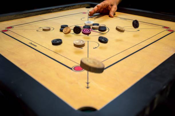 A-hard-strike-using-a-carrom-board-Home-sports-Family-sports