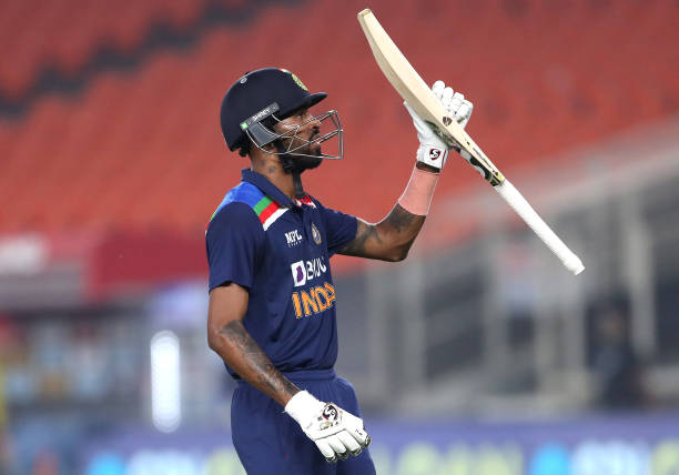 -Hardik-Pandya-of-India-raises-his-bat-as-he-leaves-the-field-after-the-firs