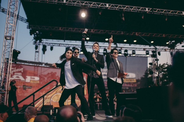 Pierce The Veil presenting Bring Me The Horizon with Best International Band award