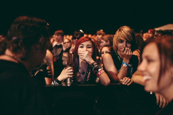 A Black Veil Brides fan in the crowd with the bands' Most Dedicated Fans award