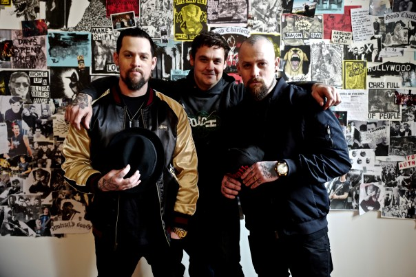 Joel and Benji Madden of Good Charlotte with Brian Montouri, the artist behind Youth Authority's album cover