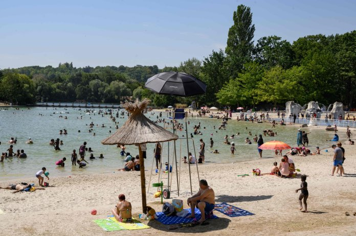 People enjoy a hot and sunny day at the Cergy-Pontoise leisure center, northwest of Paris, August 12, 2020. - Western Europe has been sweltering with a heat wave, with temperatures exceeding 35 degrees Celsius (95 F). (Photo by BERTRAND GUAY / AFP) (Photo by BERTRAND GUAY / AFP via Getty Images)