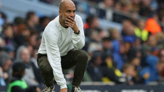 Manchester City's Spanish manager Pep Guardiola looks on from the touchline during the English Premier League football match between Manchester City and Norwich City at the Etihad Stadium in Manchester, north west England, on August 21, 2021. (Photo by Adrian DENNIS / AFP) / RESTRICTED TO EDITORIAL USE. No use with unauthorized audio, video, data, fixture lists, club/league logos or 'live' services. Online in-match use limited to 120 images. An additional 40 images may be used in extra time. No video emulation. Social media in-match use limited to 120 images. An additional 40 images may be used in extra time. No use in betting publications, games or single club/league/player publications. / (Photo by ADRIAN DENNIS/AFP via Getty Images)