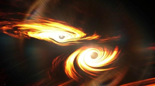 Graficzne wyobrażenie zderzających się czarnych dziur /Mark Myers, ARC Centre of Excellence for Gravitational Wave Discovery (OzGrav) /Materiały prasowe