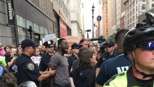 Cloud Computing: A photo released by Jews for Racial & Economic Justice of organizer Yehudah Webster being taken into custody at a recount against Amazon in Long island on Aug. eleven, 2019.