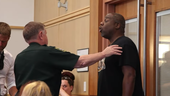 Illustration for article titled 'Keep Up These Racial Disparities': Protester Kicked Out of Courtroom for Blasting Judge Who Freed Armed White Nationalist