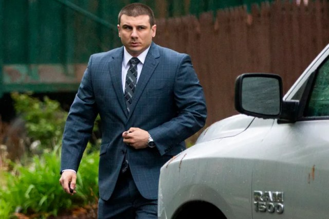New York City cop Daniel Pantaleo leaves his house May 13, 2019, in Staten Island, N.Y., as his long-delayed disciplinary trial in the death of Eric Garner is set to begin.