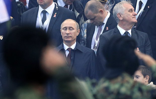 Russian President Vladimir Putin and Serbian President Tomislav Nikolic (right) at the military parade in Belgrade, 16 October 2014