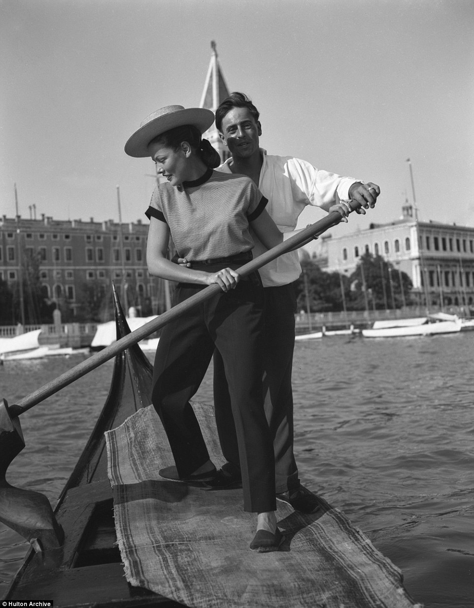 Later, donning a hat,  Gene Tierney tries her hand at rowing a gondola. She was nominated for an Academy Award for Best Actress for her performance as Ellen Berent Harland in Leave Her to Heaven