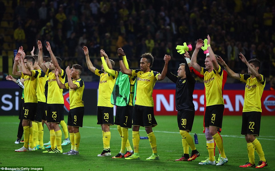 The Dortmund squad salute their home support after their secured a late draw on their home turf
