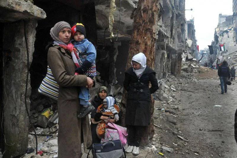 Біженці на околиці сирійської столиці Дамаск, лютий 2014 року
