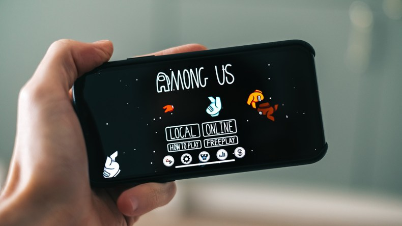 iphone with the game among us on the screen