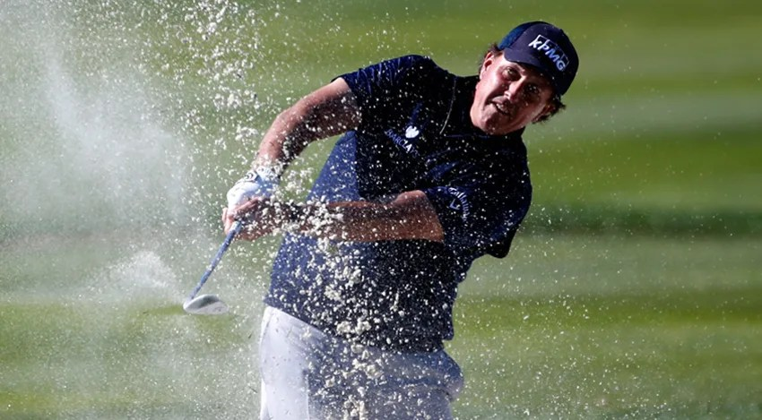 Phil Mickelson missed nine greens in Saturday's third round at Pebble Beach, but got up and down each time. (Todd Warshaw/Getty Images)