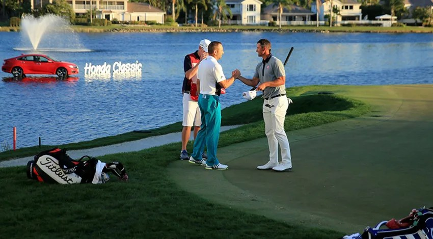 Adam Scott shakes hand with his playing partner Sergio Garcia on the 18th green during the third round. (David Cannon/Getty Images)
