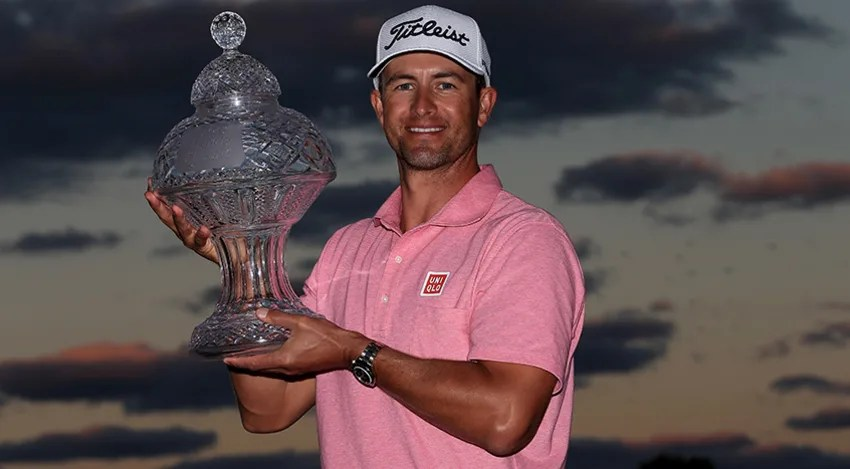 Adam Scott proudly holds the 2016 Honda Classic trophy after his one-shot victory over Sergio Garcia. (David Cannon/Getty Images)