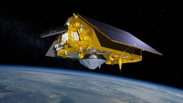 This illustration shows the Sentinel-6 Michael Freilich spacecraft in orbit above Earth with its deployable solar panels extended. Image Provided By NASA
