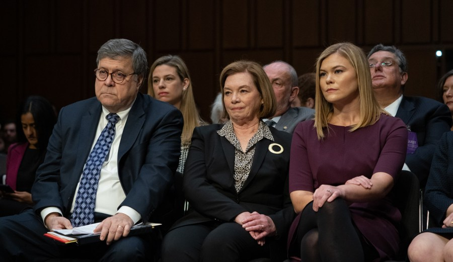 William Barr waits his turn on the stand with wife Christine and daughter Margaret during the hearing