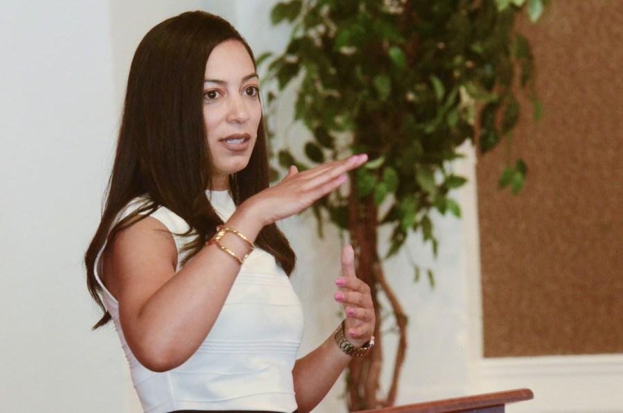 Angela Rye addressing an event