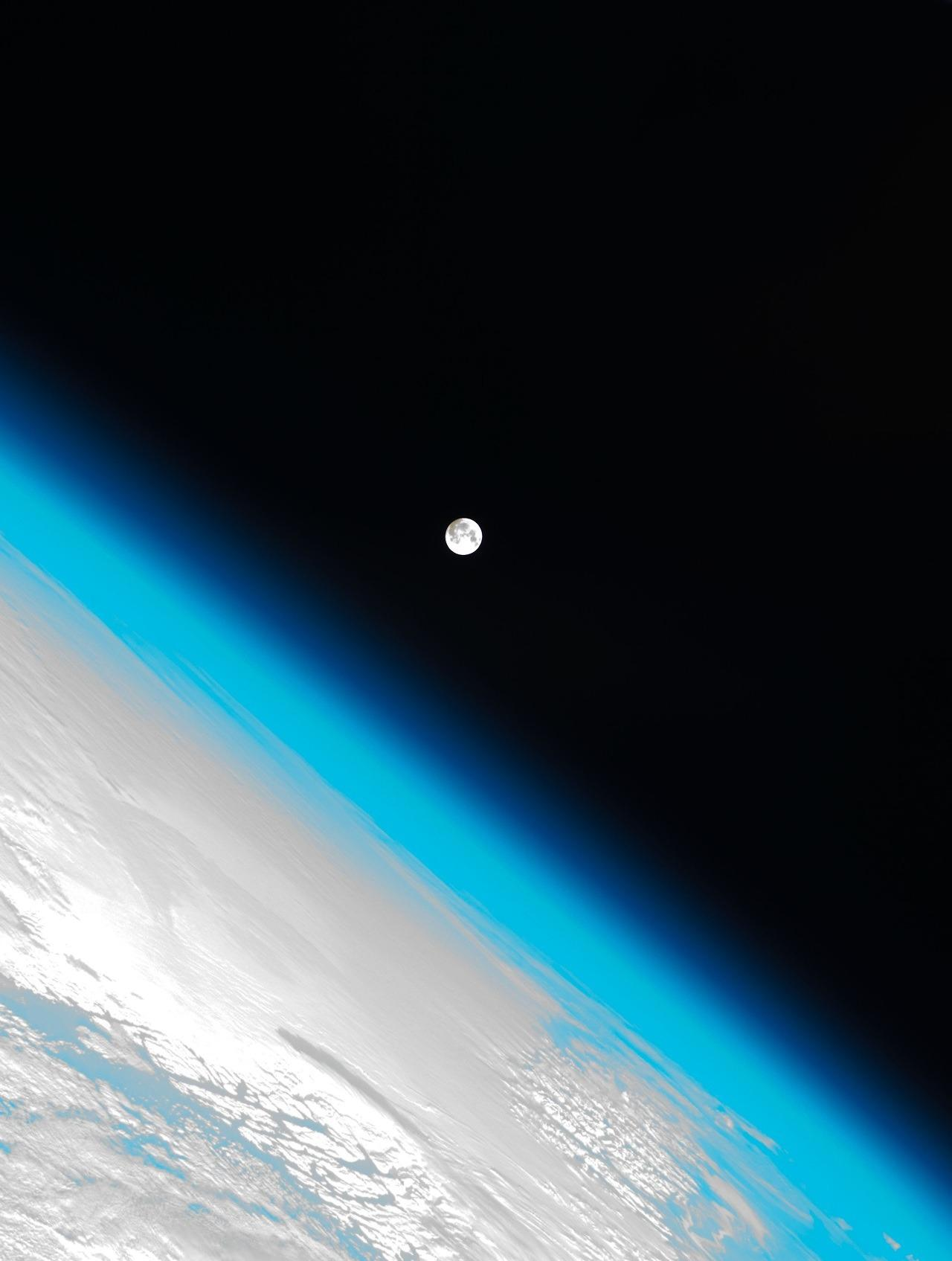 Photo Of The Earths Atmosphere And The Moon Shot By The